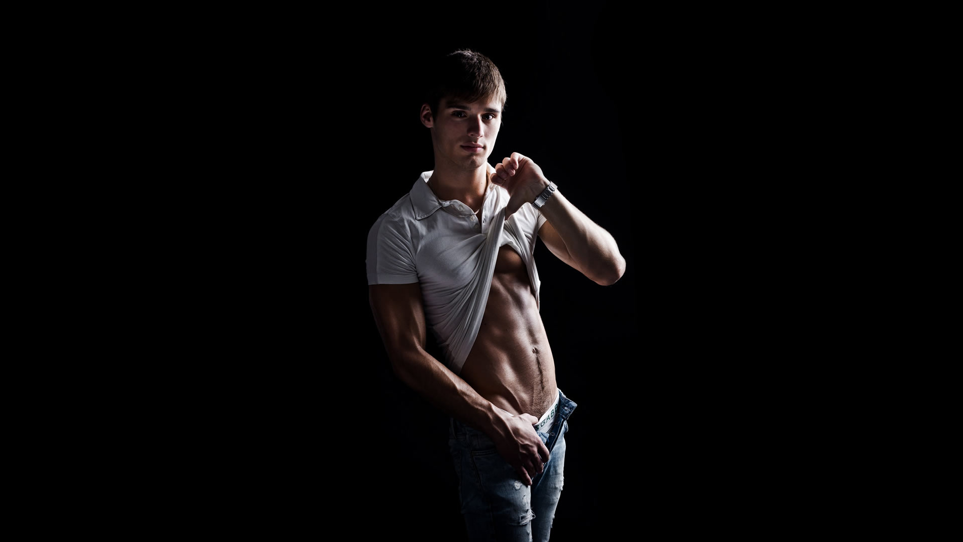 Fit Young Guy in White Polo Shirt and Jeans