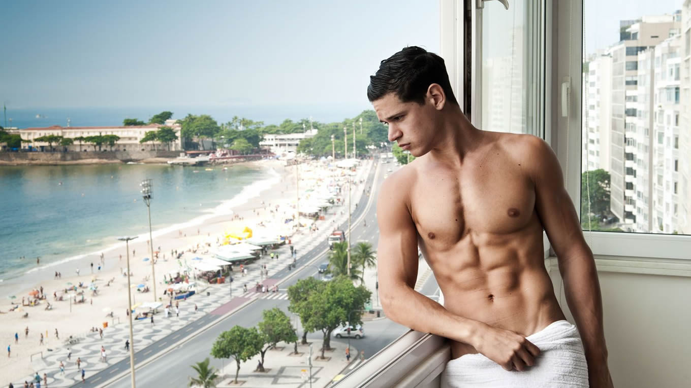 Muscular Young Stud in a Towel at the Window