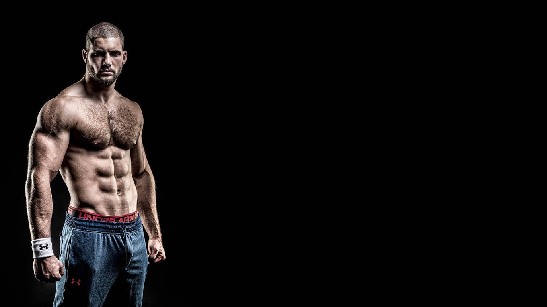 Muscular Hunk Shirtless in Blue Sweatpants