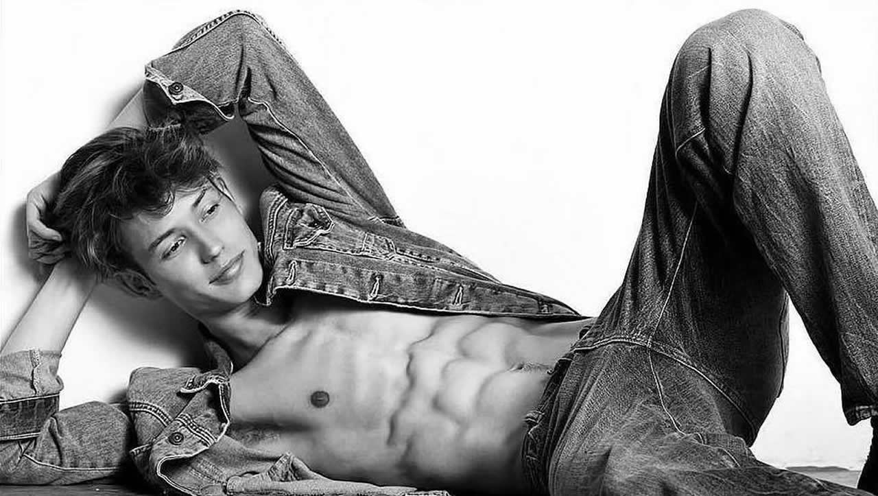 Black and White Ripped Young Guy in Denim Jacket and Jeans