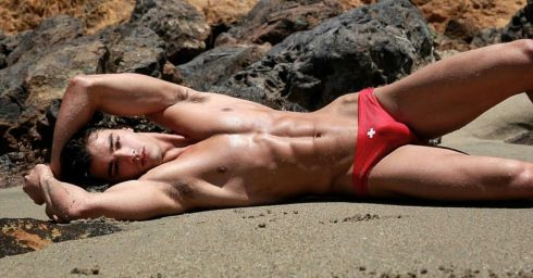 Athletic Young Guy in Red Bikini at the Beach