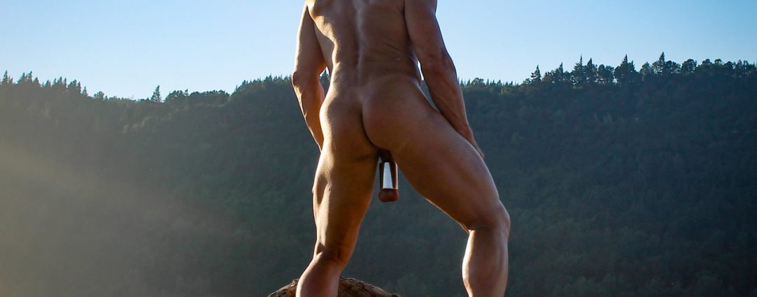 Rearview Naked Hunk with Giant Ball Stretcher Outdoors