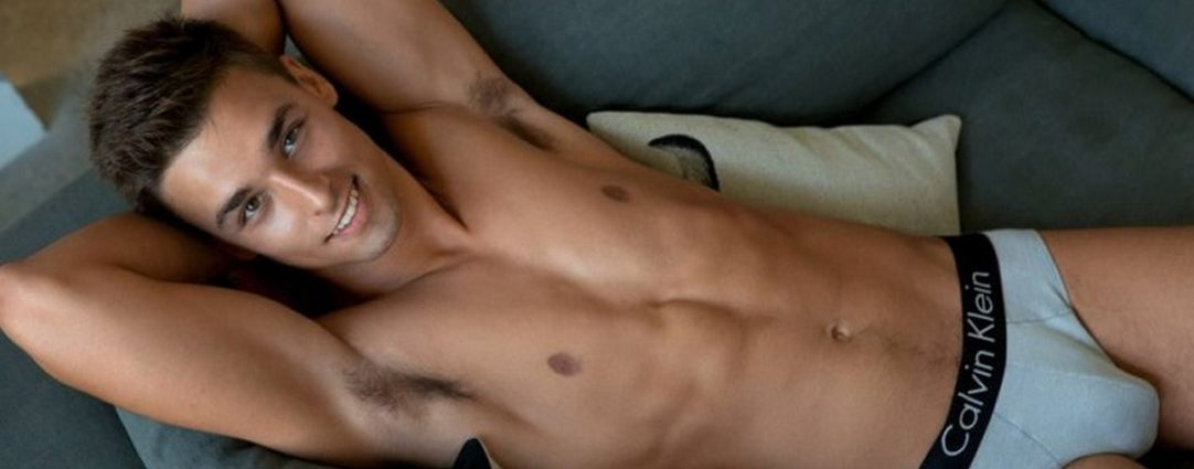 Fit Young Guy in Calvin Klein Briefs on a Sofa