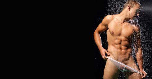 Muscular Young Guy Wearing a Sheer Bikini in the Shower