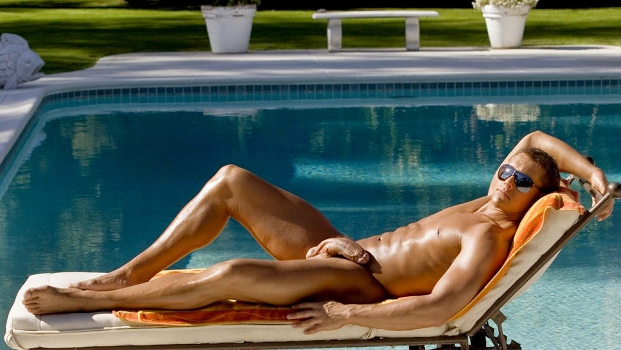 Full-Frontal Fit Stud Relaxing by a Pool