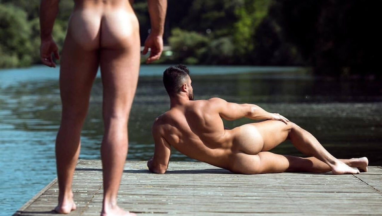 Rearview Two Naked Studs on a Dock at the River