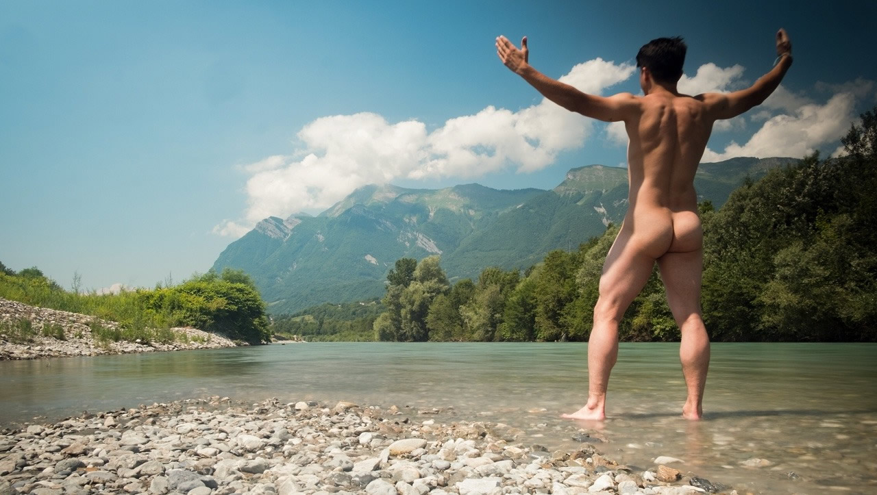 Rearview Naked Guy at the Edge of a River