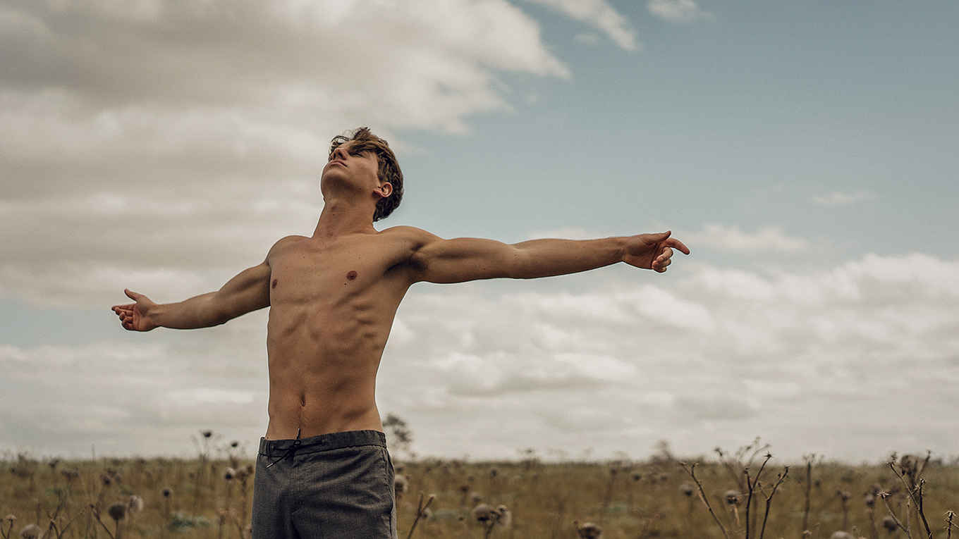 Shirtless Young Guy in a Field