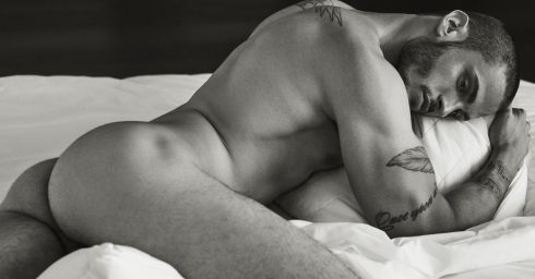 Black and White Rearview Naked Stud in Bed