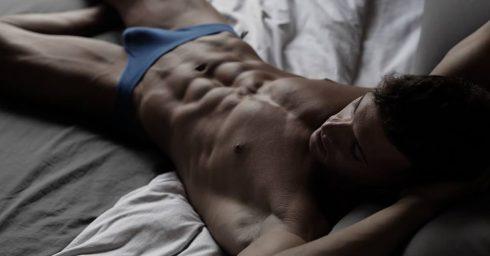 Ripped Stud Wearing Blue Bikini Briefs in Bed