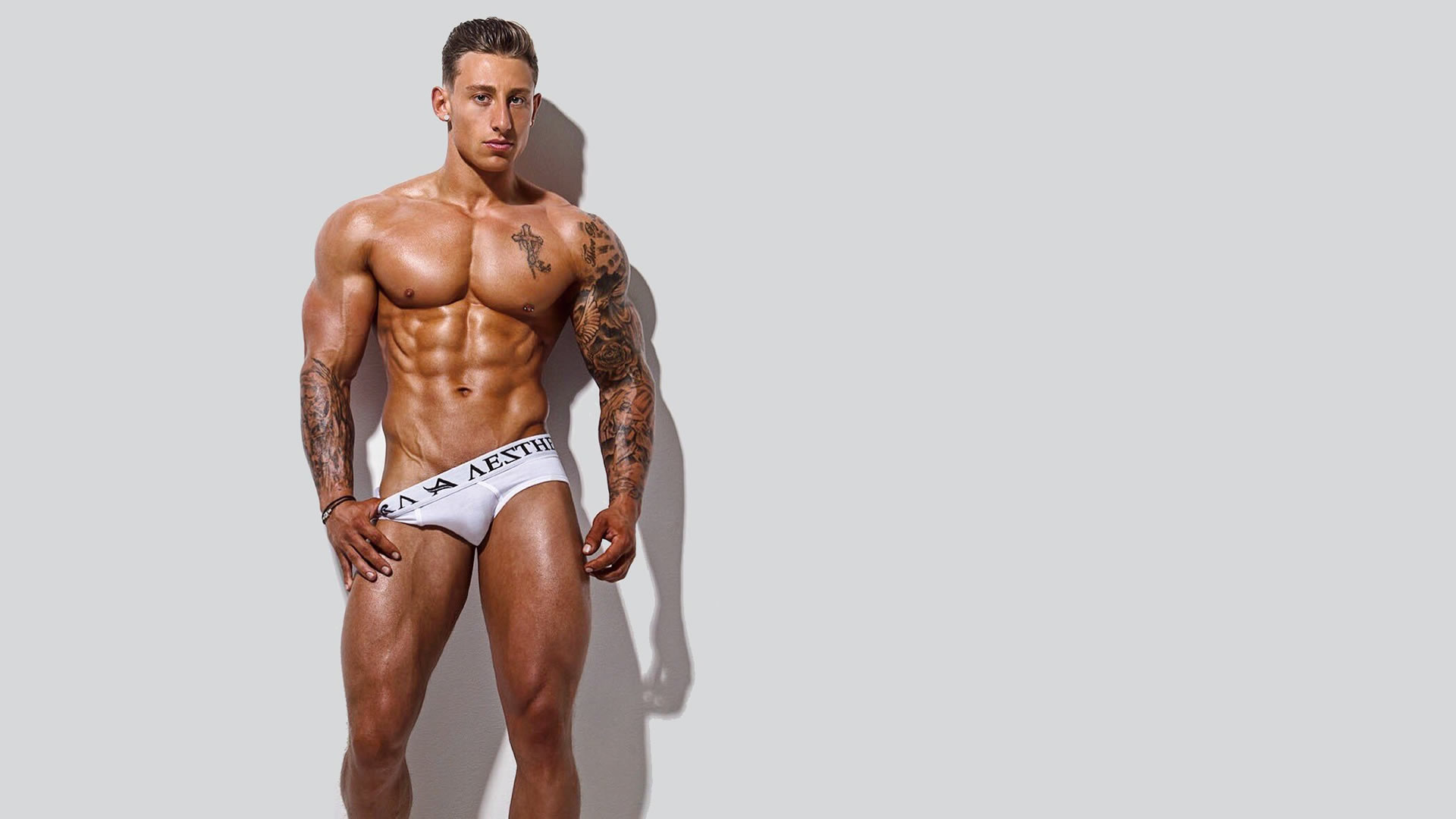 Muscular Stud in White Briefs