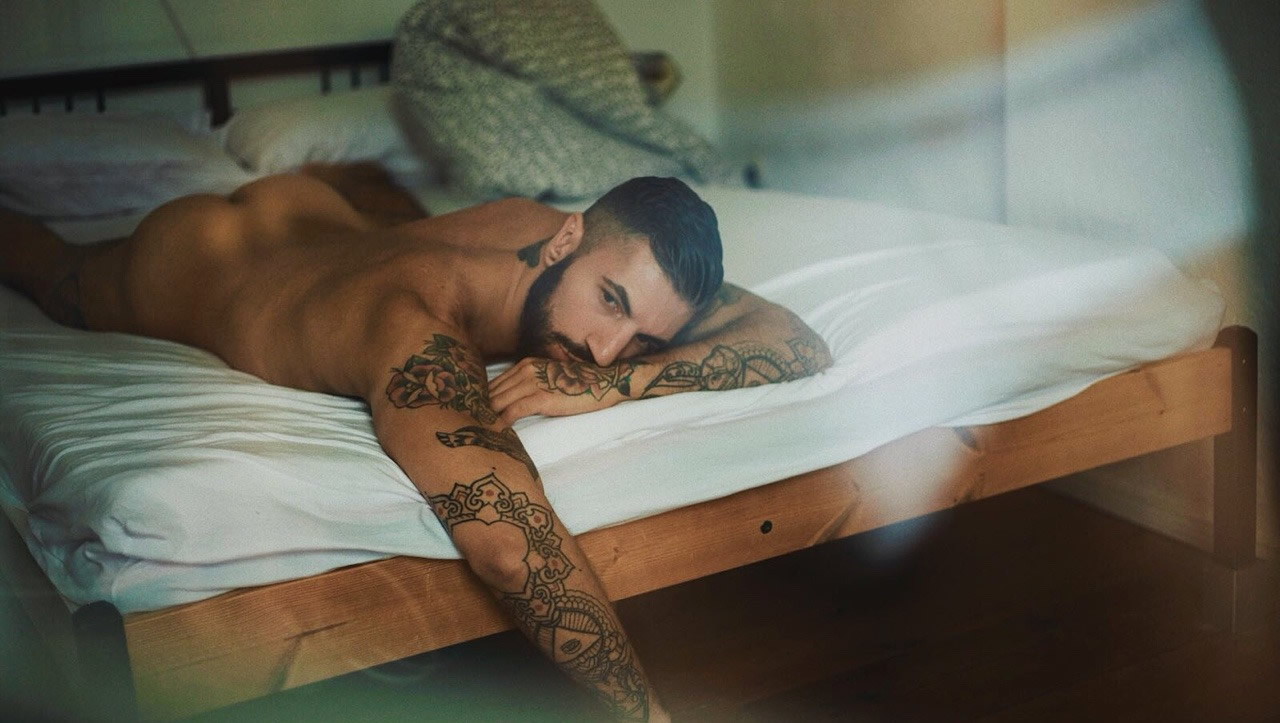 Rearview Naked Hunk in Bed