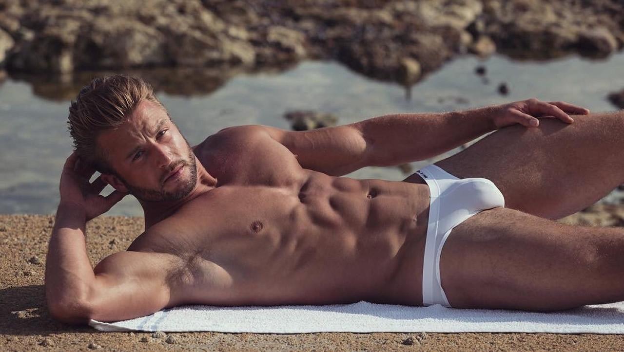 Muscular Hunk in White Bikini