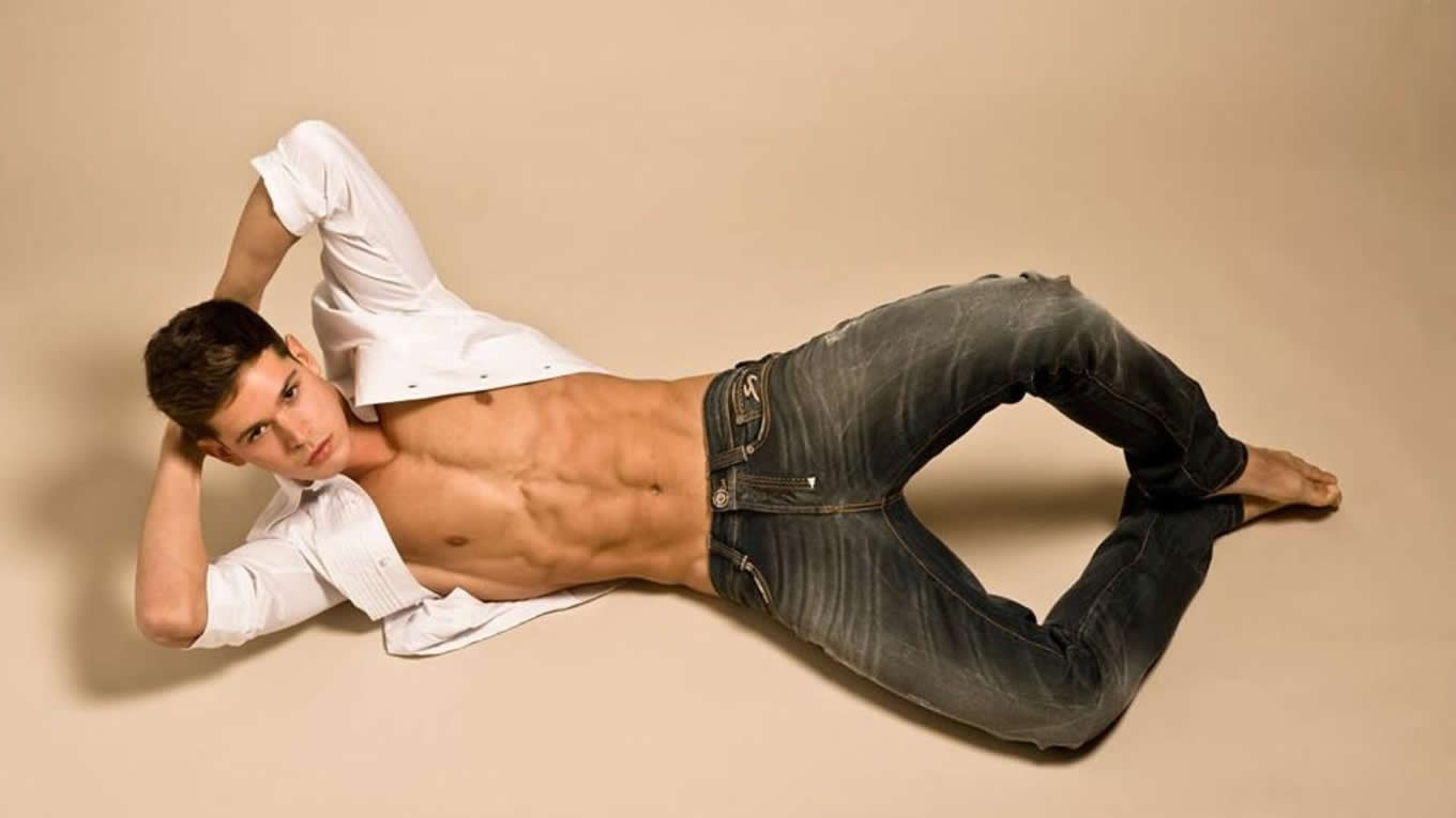 Young Guy in Jeans with Open Shirt