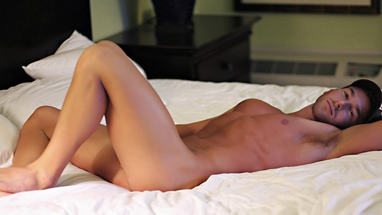 Fit Young Guy Naked on a Bed