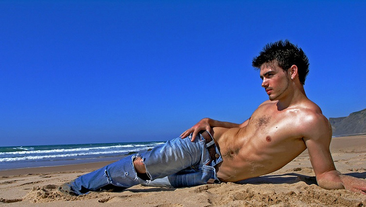 Athletic Young Guy Shirtless in Jeans on the Beach