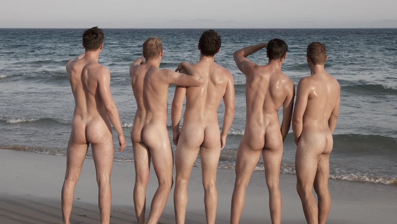 Rearview Five Naked Guys at the Edge of the Ocean