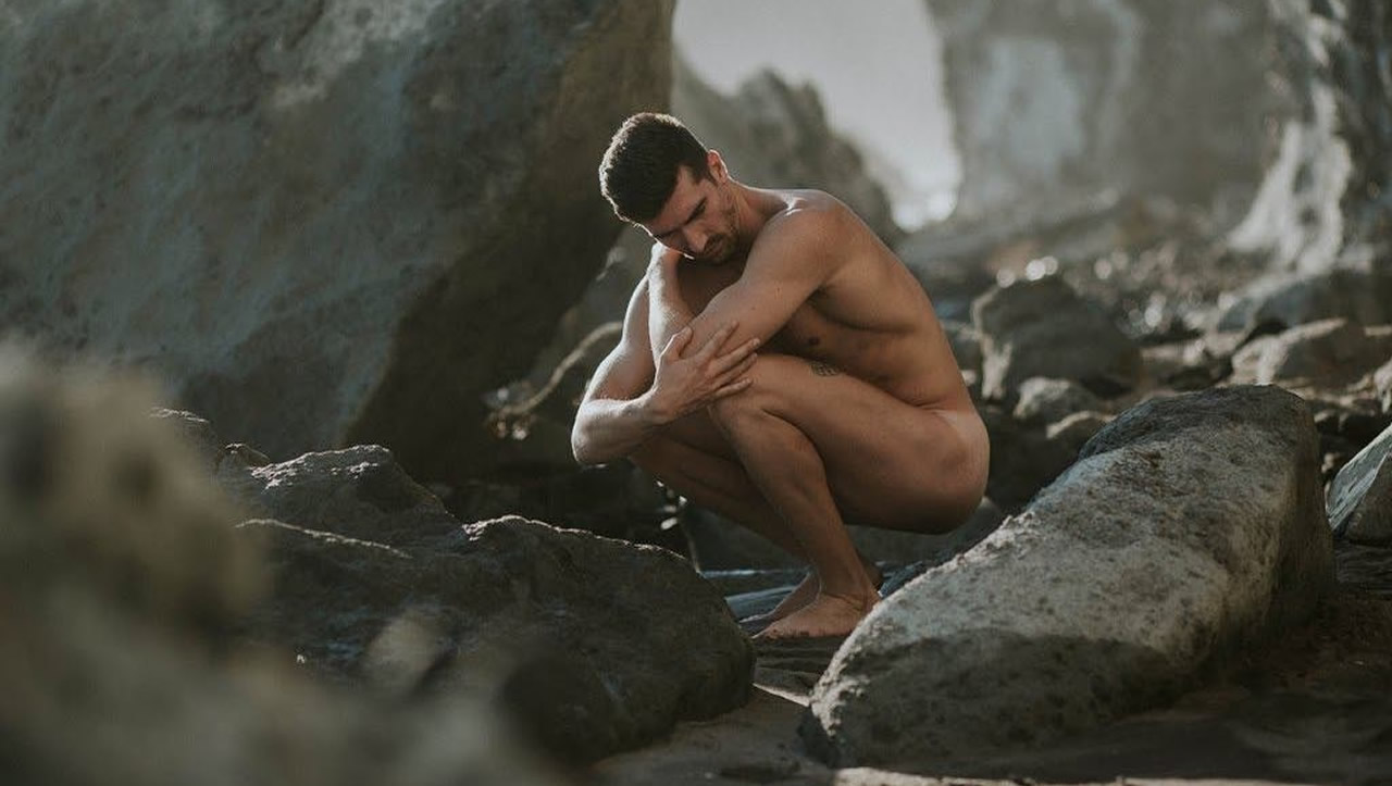 Naked Hunk Among the Rocks