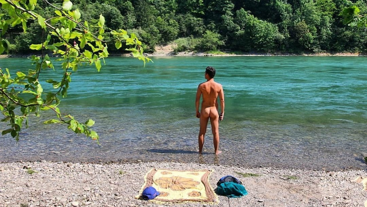 Rearview Naked Hunk at the Edge of a River