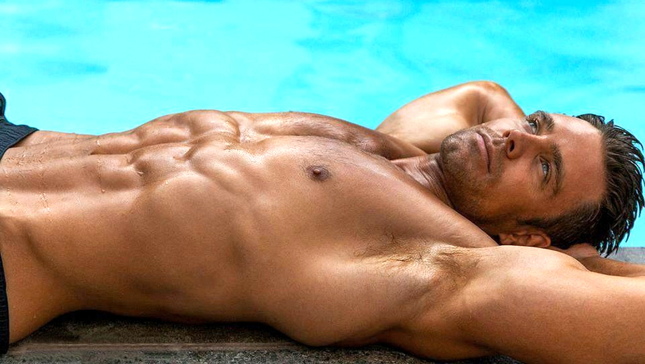 Shirtless Hunk at the Edge of a Pool