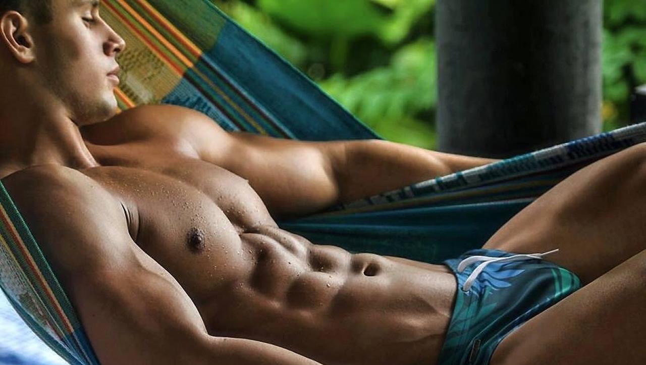 Ripped Guy in Tropical Print Bikini in a Hammock