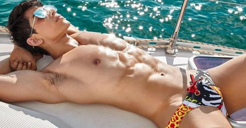 Fit Young Guy in a Bikini Sunning on a Boat