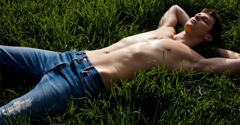 Young Guy Shirtless in Jeans on the Grass