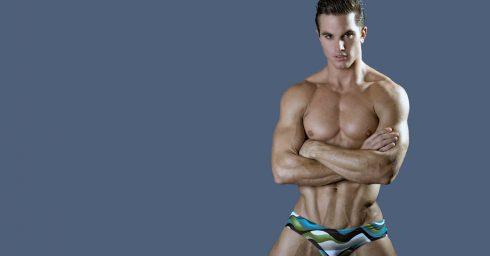 Muscular Young Guy in Green and Blue Bikini