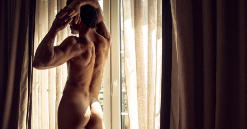 Rearview Athletic Guy Naked in Front of French Doors