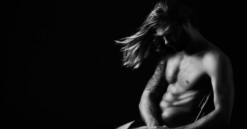 Fit Young Guy with Long Hair Shirtless