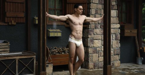 Muscular Young Guy in White Briefs Standing on the Porch