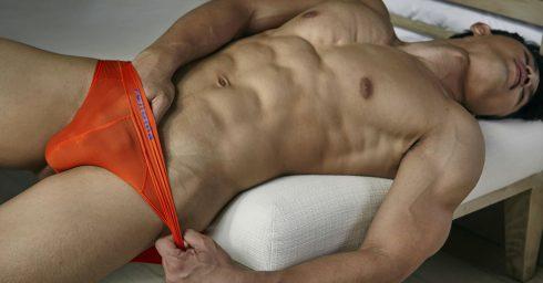 Muscular Young Guy in an Orange Bikini