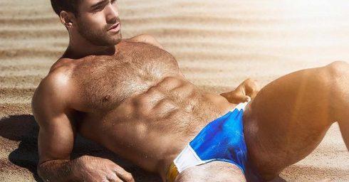 Athletic Hunk in Blue Bikini at the Beach