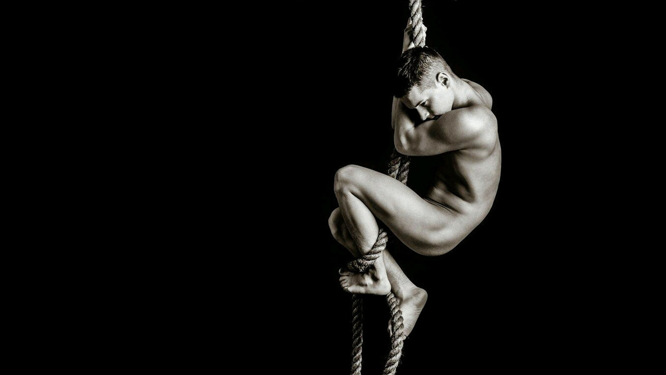 Black and White Naked Guy Climbing a Rope