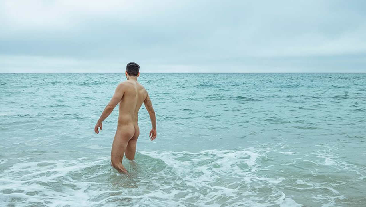 Rearview Naked Hunk in the Ocean