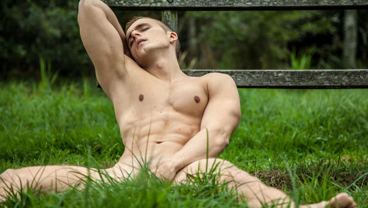 Athletic Young Stud Naked in the Grass