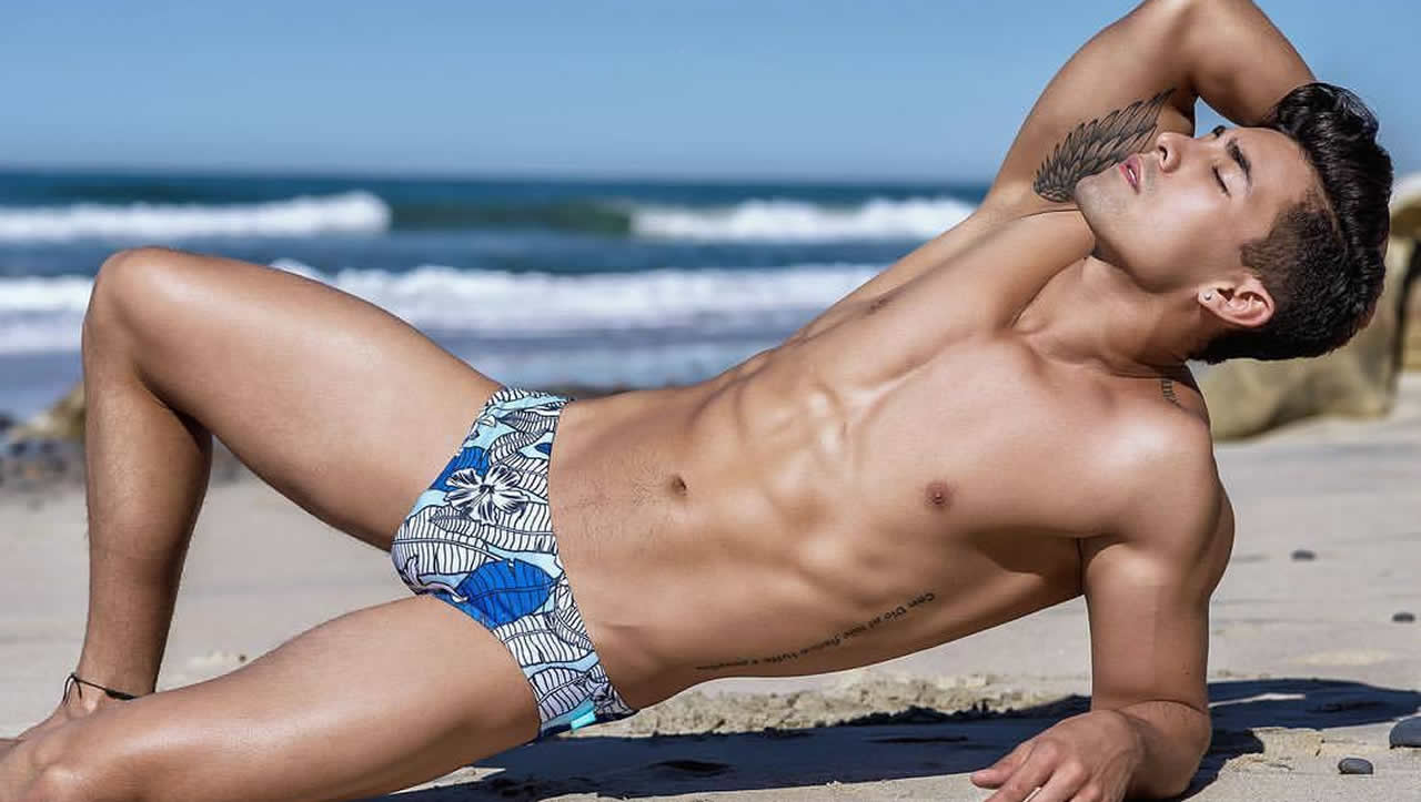 Athletic Guy in a Blue Print Bikini at the Beach