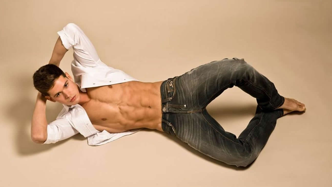 Fit Young Guy with an Open Shirt in Jeans