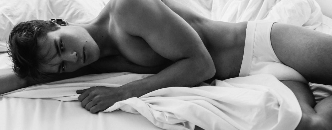 Black and White Young Guy in Bed Wearing White Briefs