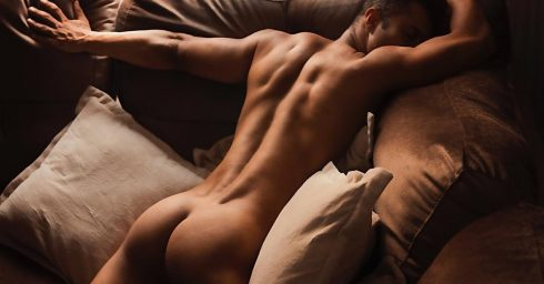 Rearview Fit Young Guy on the Sofa