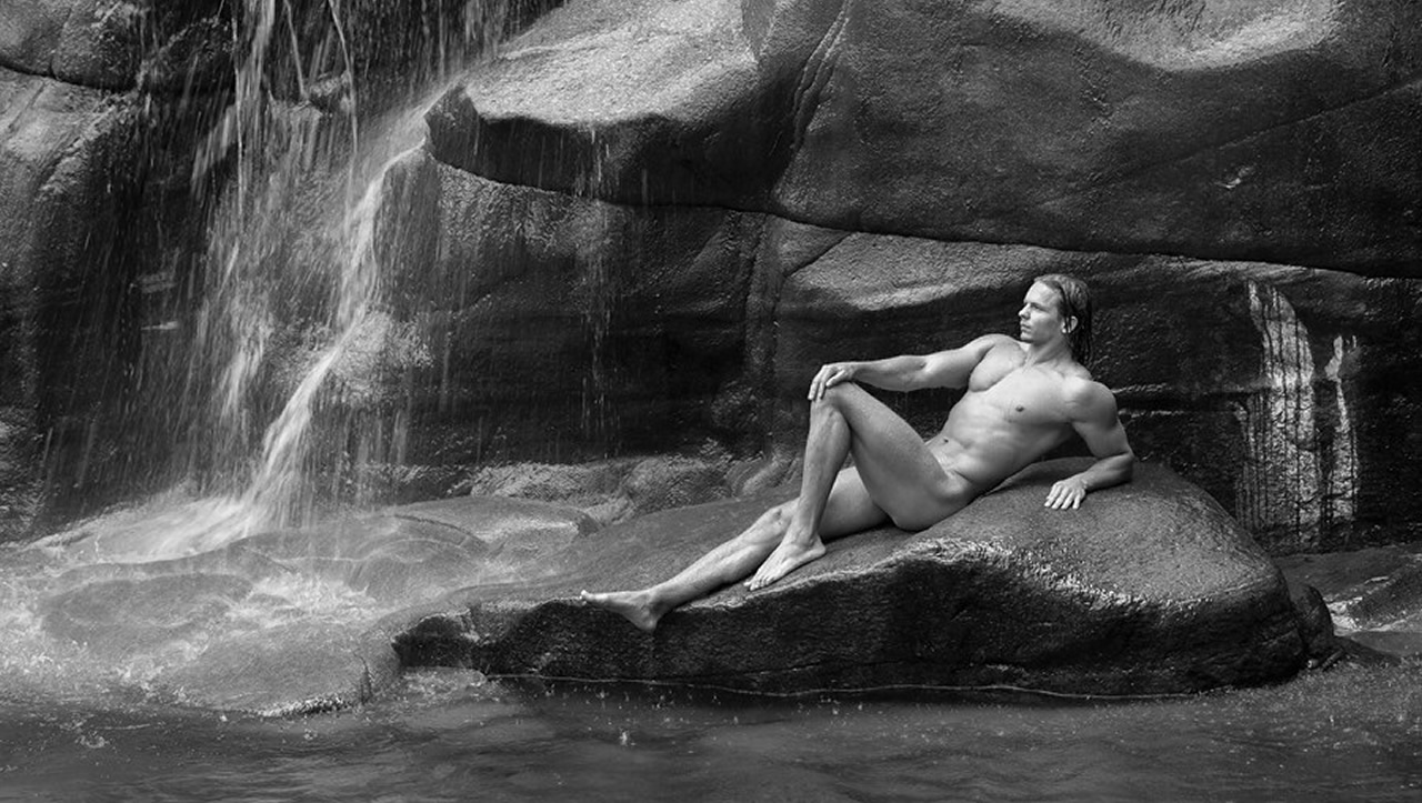 Black and White Muscular Stud Naked on a Rock in a Waterfall