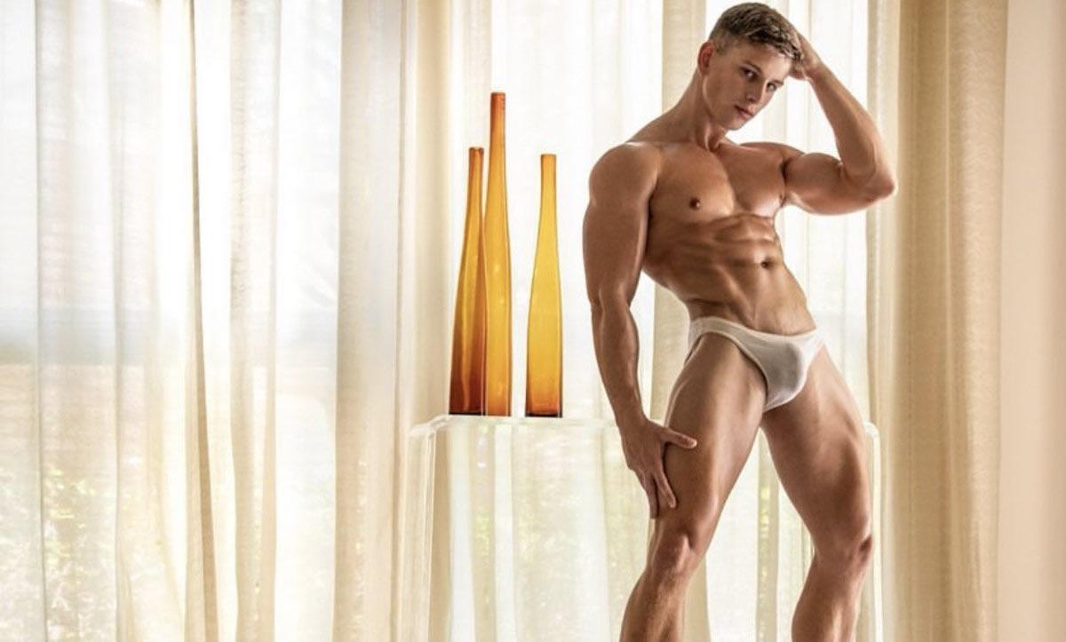 Muscular Young Stud in a White Bikini