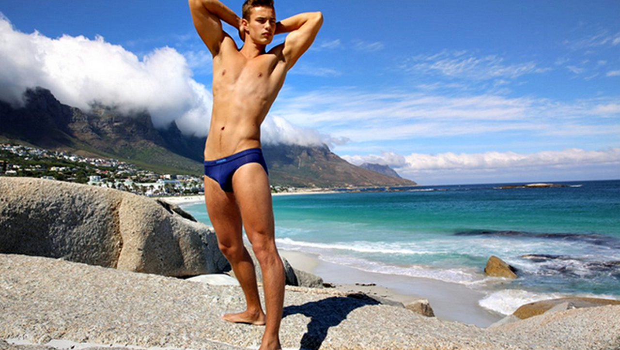 Fit Young Guy at the Edge of the Ocean
