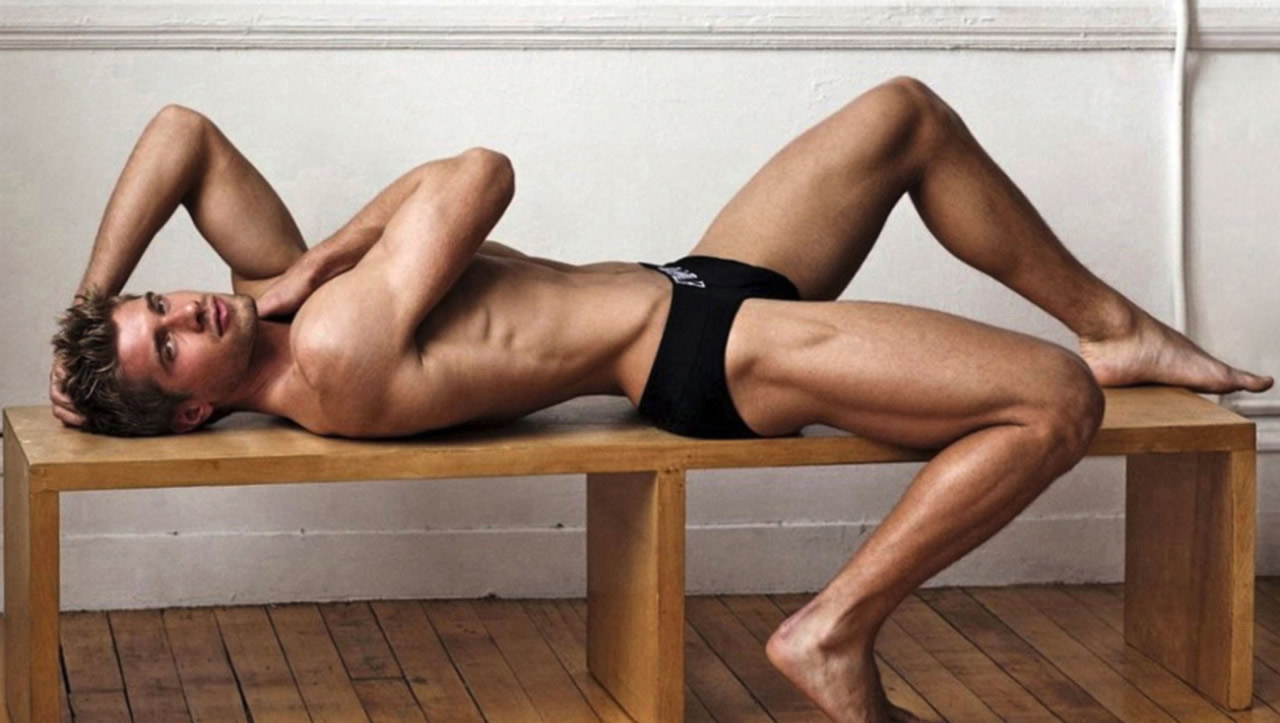 Fit Guy in Black Briefs on a Bench
