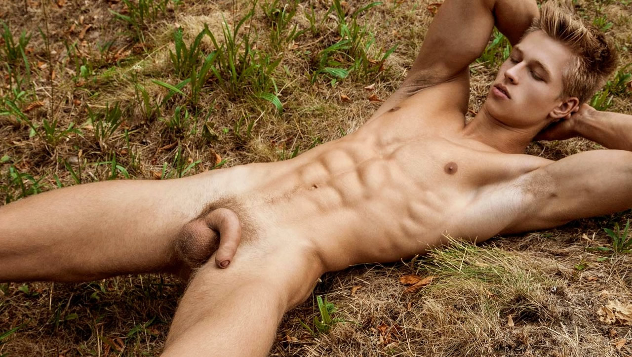 Full-Frontal Fit Young Guy in a Field