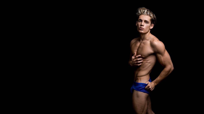 Muscular Young Stud in Blue Calvin Klein Briefs