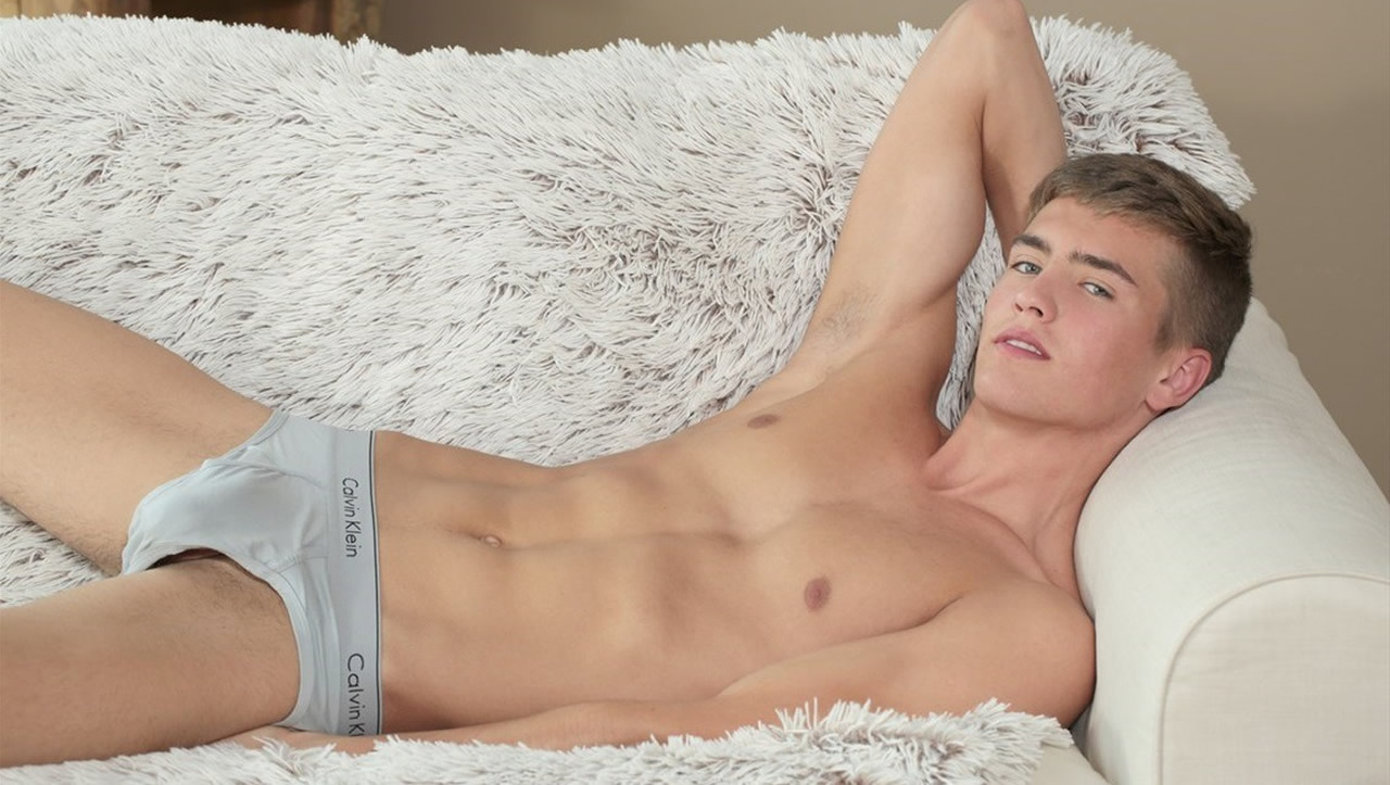 Young Guy in Grey Calvin Klein Briefs on a Sofa