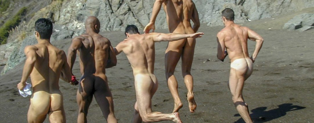 Rearview Five Guys Running Naked on the Beach